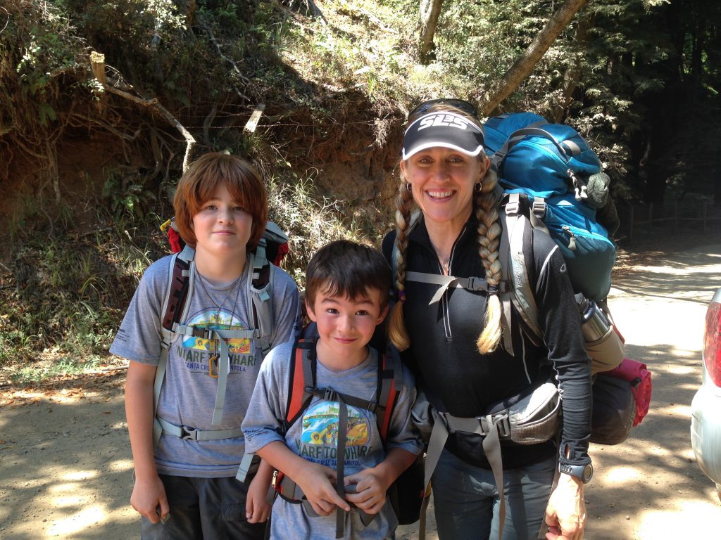 Dena hiking with her son