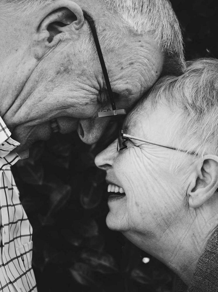 black and white photo of senior couple touching foreheads